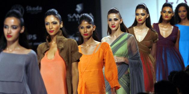Models present creations by Indian designer Rodricks in Mumbai